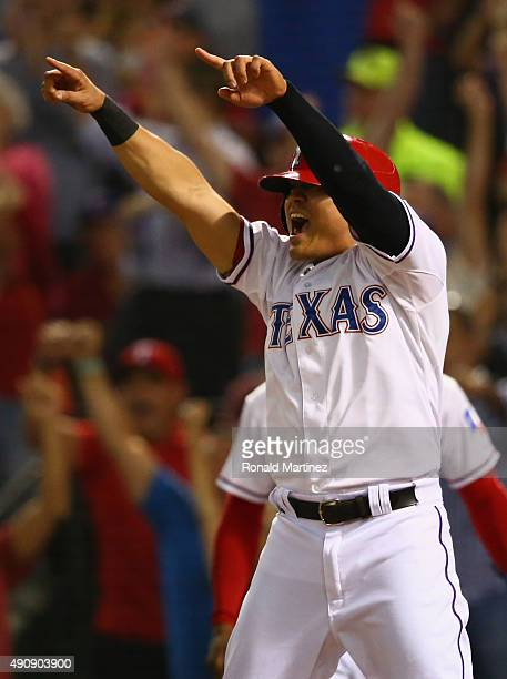 ShinSoo Choo of the Texas Rangers celebrates after scoring against the Los Angeles Angels in the fifth inning at Globe Life Park in Arlington on...