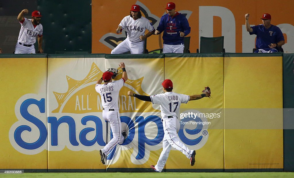 Shin-Soo Choo #17 of the Texas Rangers celebrates as Drew Stubbs #15 of the Texas Rangers fields a fly ball for the final out in the top of the ninth inning against the Detroit Tigers at Globe Life Park in Arlington on September 29, 2015 in Arlington, Texas.