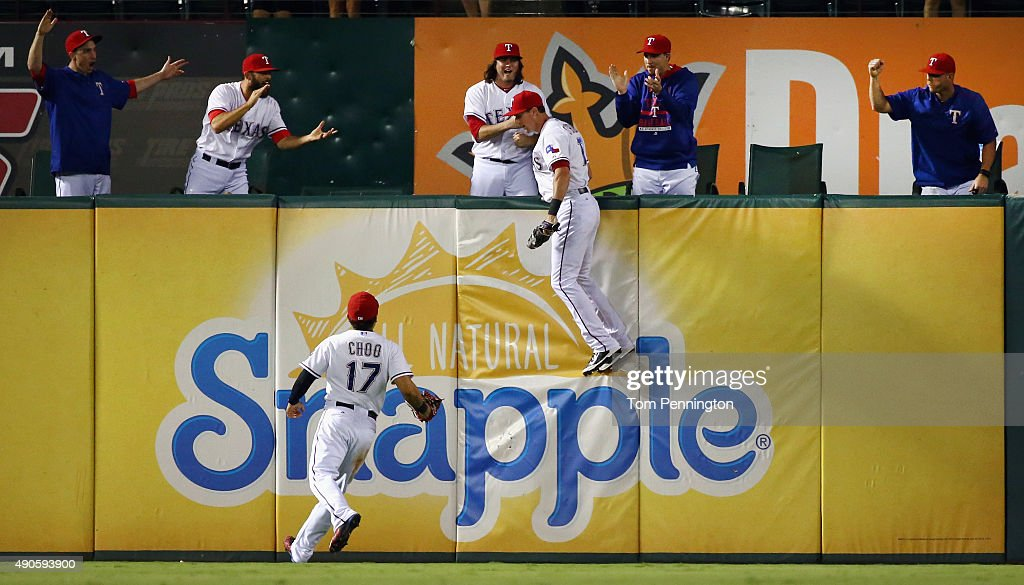 <a gi-track='captionPersonalityLinkClicked' href=/galleries/search?phrase=Shin-Soo+Choo&family=editorial&specificpeople=196543 ng-click='$event.stopPropagation()'>Shin-Soo Choo</a> #17 of the Texas Rangers celebrates as <a gi-track='captionPersonalityLinkClicked' href=/galleries/search?phrase=Drew+Stubbs+-+Baseball+Player&family=editorial&specificpeople=4498334 ng-click='$event.stopPropagation()'>Drew Stubbs</a> #15 of the Texas Rangers fields a fly ball for the final out in the top of the ninth inning against the Detroit Tigers at Globe Life Park in Arlington on September 29, 2015 in Arlington, Texas.