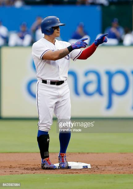 ShinSoo Choo of the Texas Rangers celebrates hitting a double during the first inning of a baseball game against the Los Angeles Angels of Anaheim at...