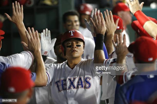 ShinSoo Choo of the Texas Rangers celebrates with teammates after scoring a run against the New York Yankees during the fifth inning of the Texas...