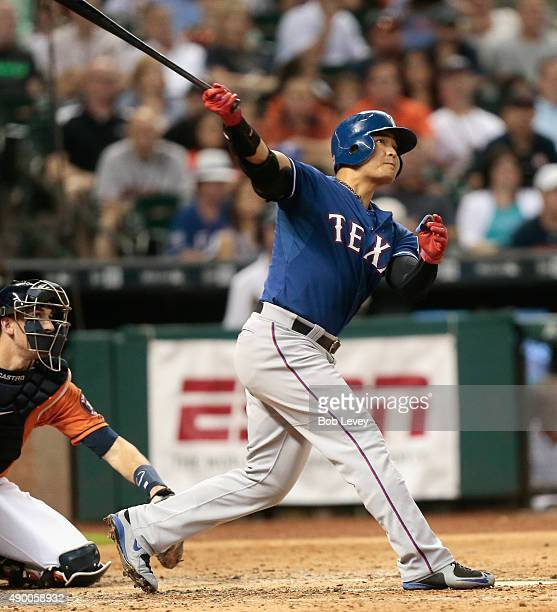 ShinSoo Choo of the Texas Rangers hits a home run in the fourth inning against the Houston Astros at Minute Maid Park on September 25 2015 in Houston...