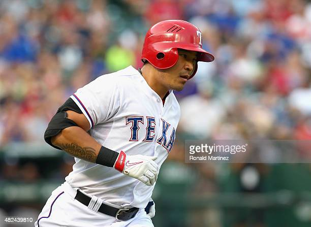 ShinSoo Choo of the Texas Rangers hits a homerun against the New York Yankees in the second inning at Globe Life Park in Arlington on July 30 2015 in...
