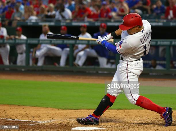 ShinSoo Choo of the Texas Rangers hits a one run single in the third inning against the Chicago White Sox at Globe Life Park in Arlington on August...