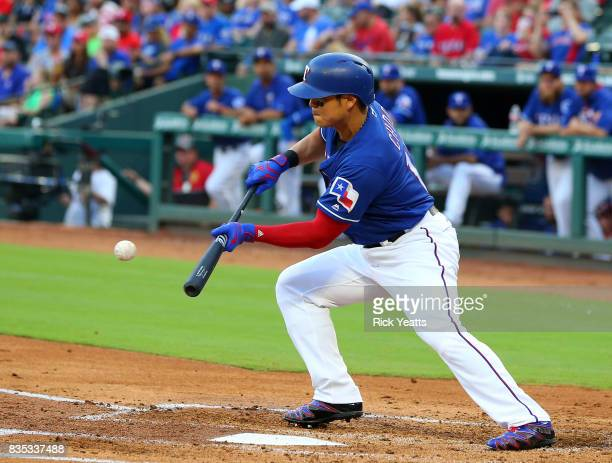 ShinSoo Choo of the Texas Rangers hits a sacrifice bunt in the first inning against the Chicago White Sox at Globe Life Park in Arlington on August...