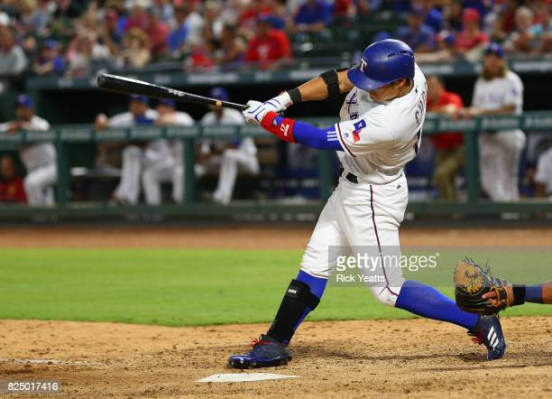 ShinSoo Choo of the Texas Rangers hits a single in the sixth inning against the Seattle Mariners at Globe Life Park in Arlington on July 31 2017 in...