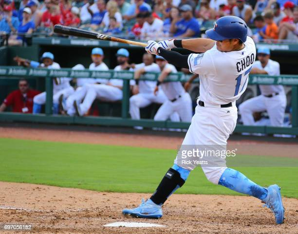 ShinSoo Choo of the Texas Rangers hits a two run home run in the sixth inning against the Seattle Mariners at Globe Life Park in Arlington on June 17...