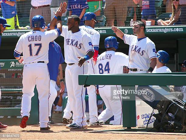 ShinSoo Choo of the Texas Rangers Ian Desmond and Prince Fielder celebrate with their team mates for Fielder's three run home run in the sixth inning...