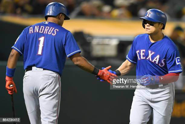 ShinSoo Choo of the Texas Rangers is congratulated by Elvis Andrus after Choo hit a solo home run against the Oakland Athletics in the top of the...