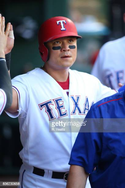 ShinSoo Choo of the Texas Rangers is congratulated for scoring in the first inning against the Chicago White Sox at Globe Life Park in Arlington on...