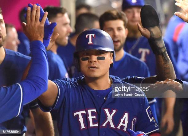 ShinSoo Choo of the Texas Rangers is greeted in the dugout after hitting a two run home run in the fifth inning of the game against the Los Angeles...