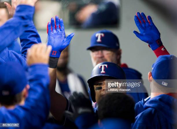 ShinSoo Choo of the Texas Rangers is greeted in the dugout after hitting a home run against the Seattle Mariners at Safeco Field on September 21 2017...