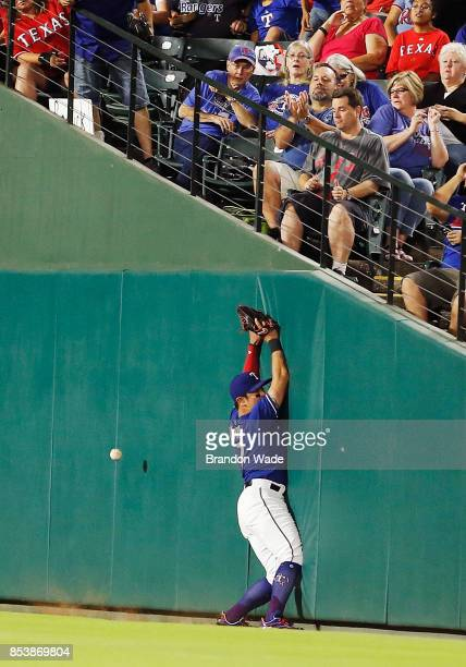 ShinSoo Choo of the Texas Rangers is unable to catch a foul ball hit by Alex Bregman of the Houston Astros during the fourth inning of a baseball...