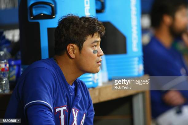 ShinSoo Choo of the Texas Rangers looks on from the dugout in the third inning against the Cleveland Indians at Globe Life Park in Arlington on April...