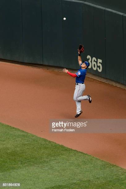 ShinSoo Choo of the Texas Rangers makes a catch in right field against the Minnesota Twins during the game on August 6 2017 at Target Field in...
