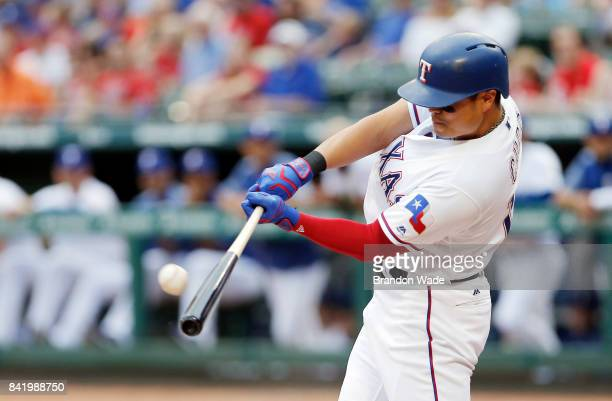 ShinSoo Choo of the Texas Rangers makes contact for a double during the first inning of a baseball game against the Los Angeles Angels of Anaheim at...