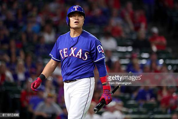 ShinSoo Choo of the Texas Rangers reacts after striking out against the Tampa Bay Rays in the bottom of the eighth inning at Globe Life Park in...