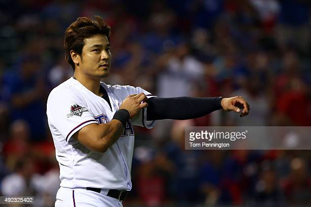 ShinSoo Choo of the Texas Rangers reacts after striking out in the eighth inning against the Toronto Blue Jays during game three of the American...