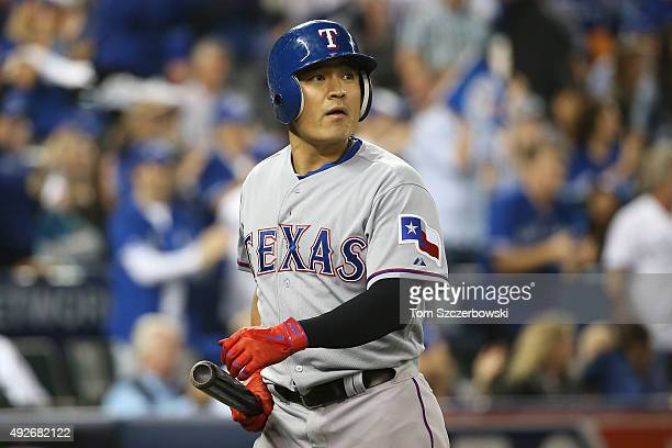 ShinSoo Choo of the Texas Rangers reacts after striking out in the fifth inning against the Toronto Blue Jays in game five of the American League...