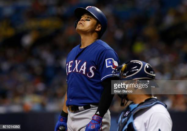ShinSoo Choo of the Texas Rangers reacts to a called strike in front of catcher Wilson Ramos of the Tampa Bay Rays during the fourth inning of a game...