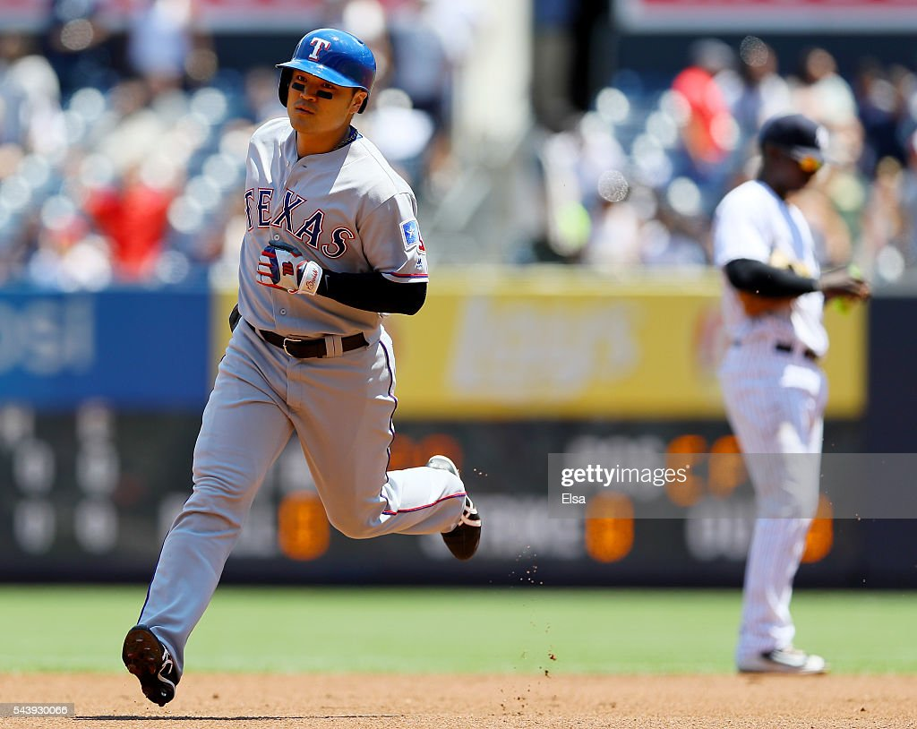 <a gi-track='captionPersonalityLinkClicked' href=/galleries/search?phrase=Shin-Soo+Choo&family=editorial&specificpeople=196543 ng-click='$event.stopPropagation()'>Shin-Soo Choo</a> #17 of the Texas Rangers rounds the bases after his solo home run in the first inning against the New York Yankees at Yankee Stadium on June 30, 2016 in the Bronx borough of New York City.