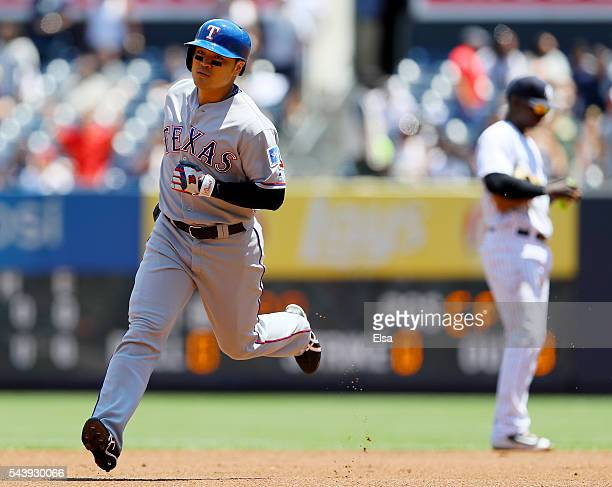 ShinSoo Choo of the Texas Rangers rounds the bases after his solo home run in the first inning against the New York Yankees at Yankee Stadium on June...