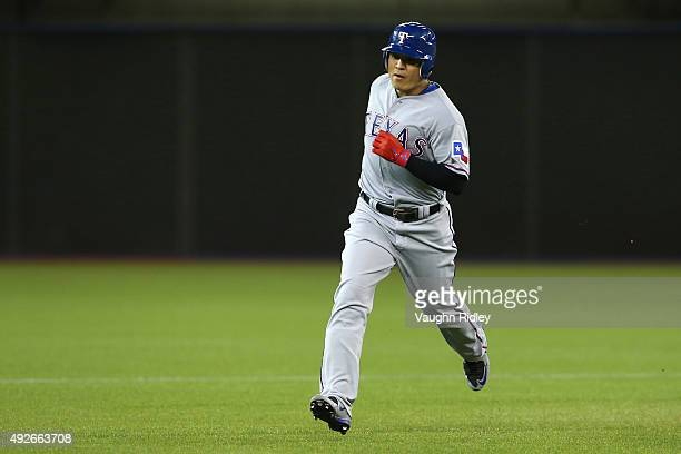 ShinSoo Choo of the Texas Rangers rounds the bases after hitting a solo home run in the third inning against the Toronto Blue Jays in game five of...