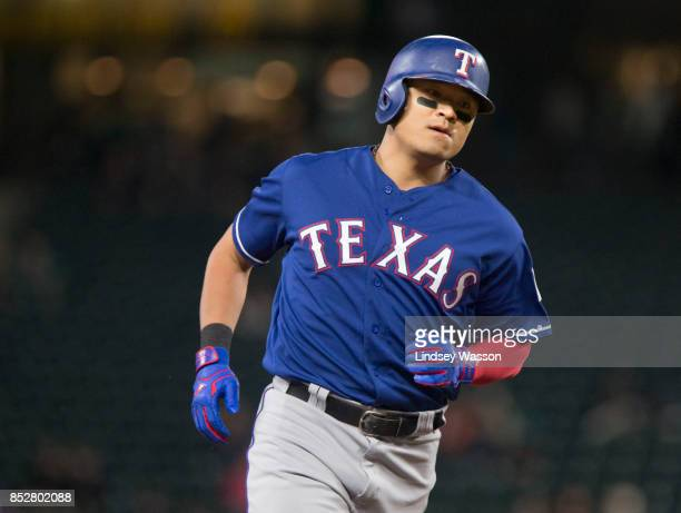 ShinSoo Choo of the Texas Rangers rounds the bases after hitting a solo home run during the game against the Seattle Mariners at Safeco Field on...
