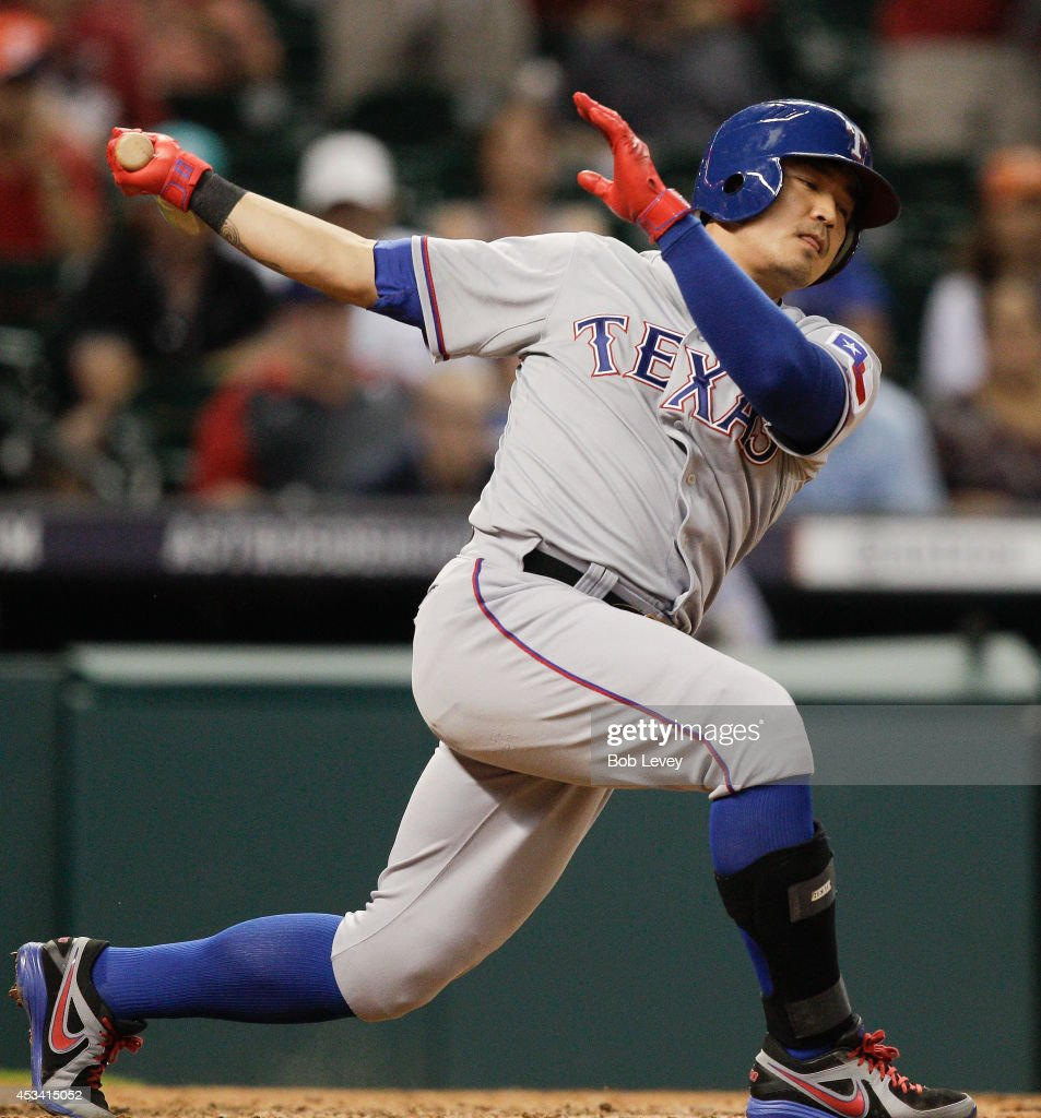 <a gi-track='captionPersonalityLinkClicked' href=/galleries/search?phrase=Shin-Soo+Choo&family=editorial&specificpeople=196543 ng-click='$event.stopPropagation()'>Shin-Soo Choo</a> #17 of the Texas Rangers singles in the ninth inning against the Houston Astros at Minute Maid Park on August 9, 2014 in Houston, Texas.