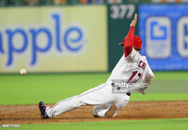 ShinSoo Choo of the Texas Rangers slides in safe to second base in the fifth inning against the Houston Astros at Globe Life Park in Arlington on...