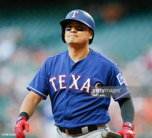 ShinSoo Choo of the Texas Rangers walks back to the dugout after striking out in the first inning against the Houston Astros at Minute Maid Park on...