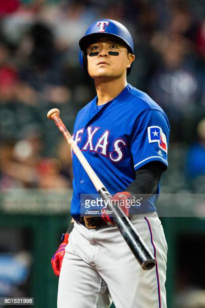ShinSoo Choo of the Texas Rangers walks back to the dugout after striking out during the ninth inning against the Cleveland Indians at Progressive...