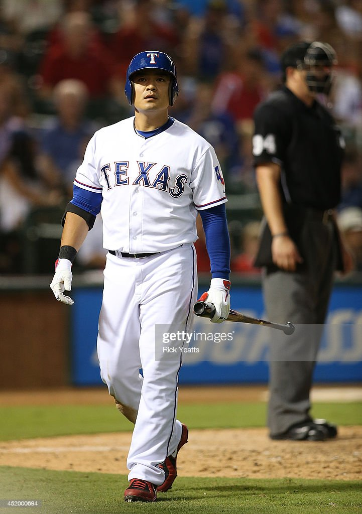 <a gi-track='captionPersonalityLinkClicked' href=/galleries/search?phrase=Shin-Soo+Choo&family=editorial&specificpeople=196543 ng-click='$event.stopPropagation()'>Shin-Soo Choo</a> #17 of the Texas Rangers walks to the dugout after striking out in the fifth inning against the Los Angeles Angels of Anaheim at Globe Life Park in Arlington on July 10, 2014 in Arlington, Texas.