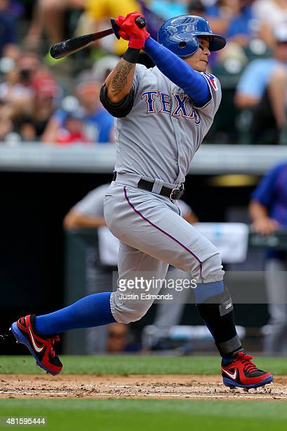 ShinSoo Choo of the Texas Rangers watches his RBI single in the first inning against the Colorado Rockies during Interleague play at Coors Field on...