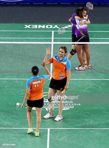 Shinta Mulia Sari and Lei Yao of Singapore celebrate victory in their women's doubles match over Ashwini Ponnappa and Jwala Gutta of India to seal...