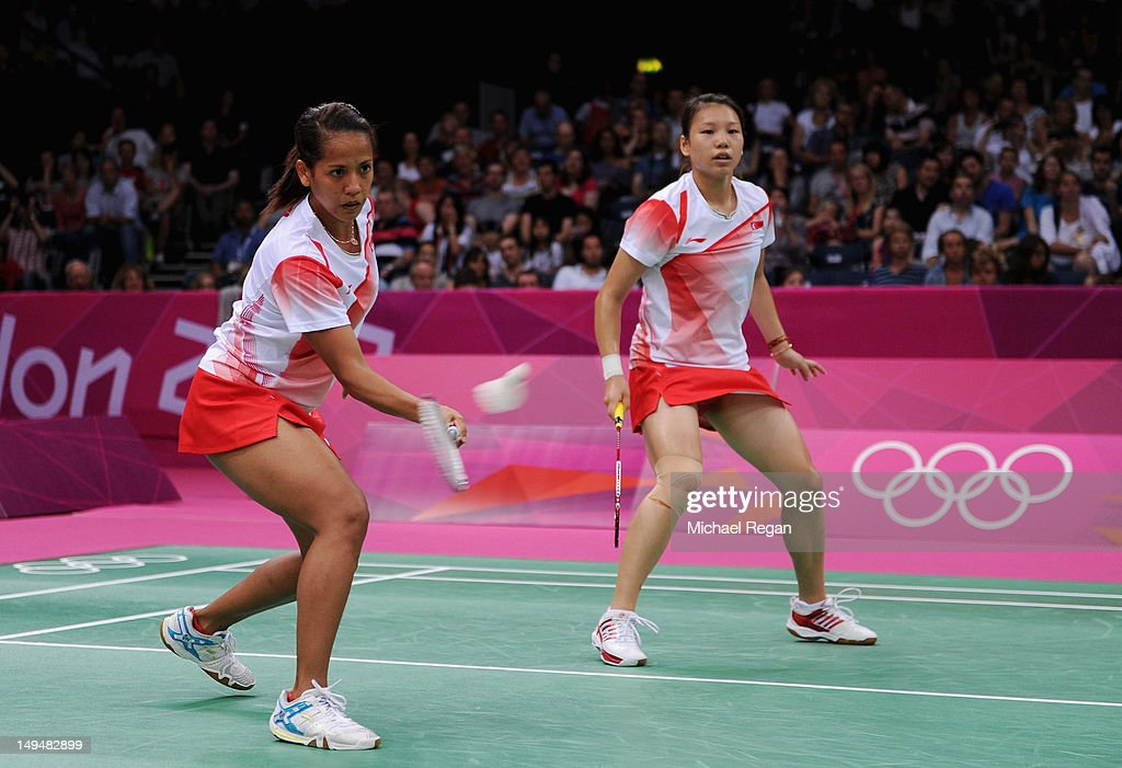 Shinta Mulia Sari (L) and Lei Yao (R) of Singapore return a shot against of Reika Kakiiwa and Mizuki Fujii of Japan during their Women's Singles Badminton on Day 2 of the London 2012 Olympic Games at Wembley Arena on July 29, 2012 in London, England.