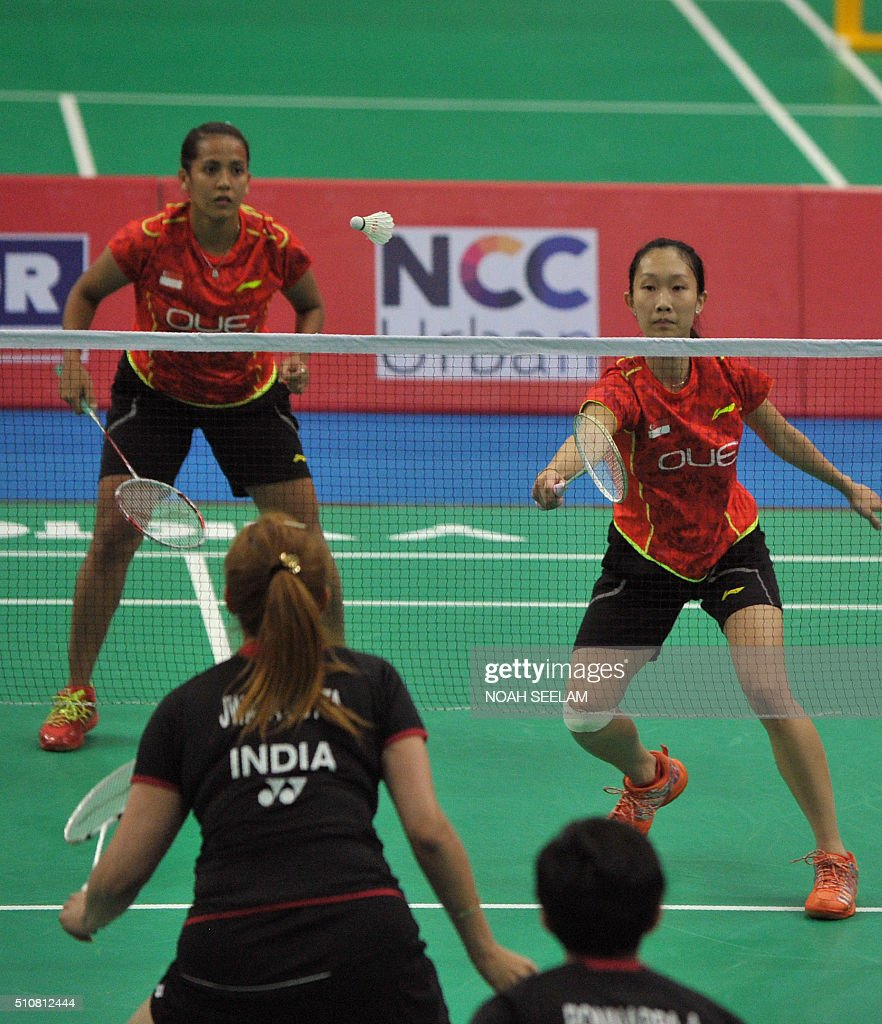 Shinta Mulia Sari and Wei Han Tan R of Singapore play against