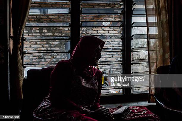 Shinta Ratri a leader of a Islamic school for transgender AlFatah known as 'waria' sits at her house who is also previously a place for a Islamic...