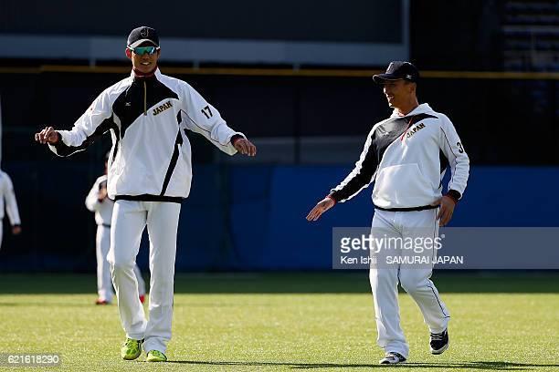 Shintaro Fujinami and Motohiro Shima of Samurai Japan warm up during the Japan national baseball team practice session at the QVC on November 7 2016...