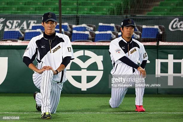 Shintaro Fujinami and Takahiro Matsuba of Samurai Japan stretch during a training session at Fukuoka Yahuoku Dome on November 9 2014 in Fukuoka Japan