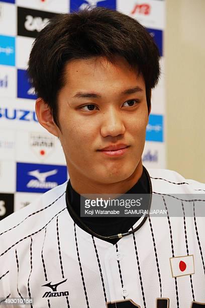 Shintaro Fujinami of Samurai Japan is interviewed before a training session at Fukuoka Yahuoku Dome on November 9 2014 in Fukuoka Japan