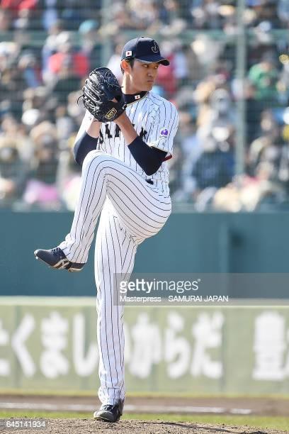 Shintaro Fujinami of Samurai Japan pitches in the sixth inning during the SAMURAI JAPAN Friendly Opening Match between SAMURAI JAPAN and Fukuoka...