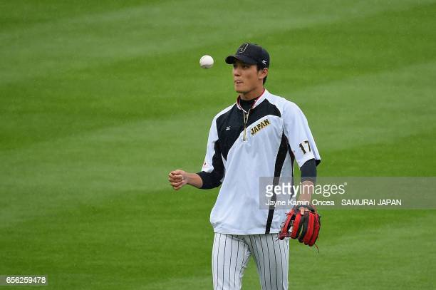 Shintaro Fujinami of the Japan is seen during warm ups before taking on team United States during Game 2 of the Championship Round of the 2017 World...