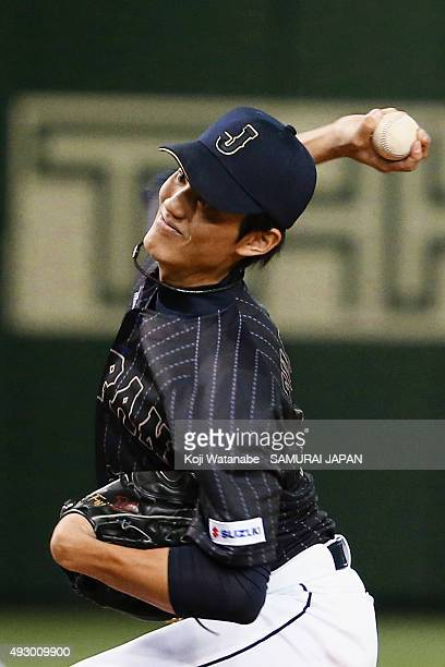 Shintaro Fujinami pitches during the game four of Samurai Japan and MLB All Stars at Tokyo Dome on November 16 2014 in Tokyo Japan