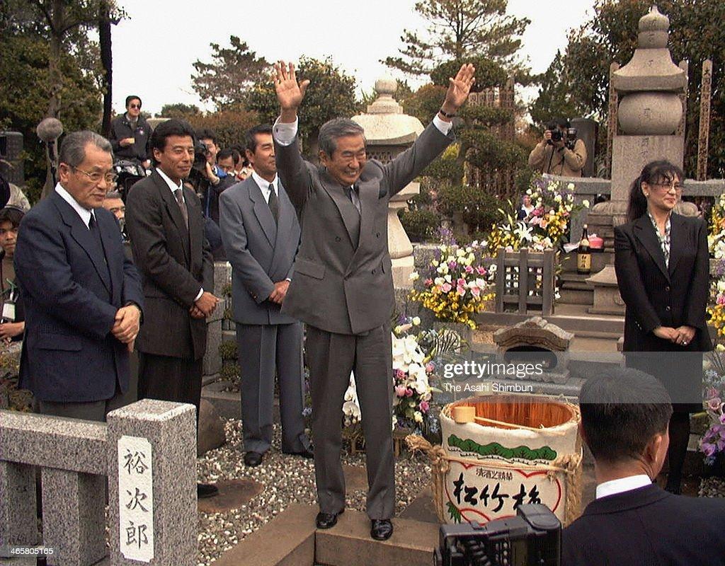 Shintaro Ishihara visits the grave of brother and actor Yujiro Ishihara after being elected as Governor of Tokyo on April 12, 1999 in Yokohama, Kanagawa, Japan.