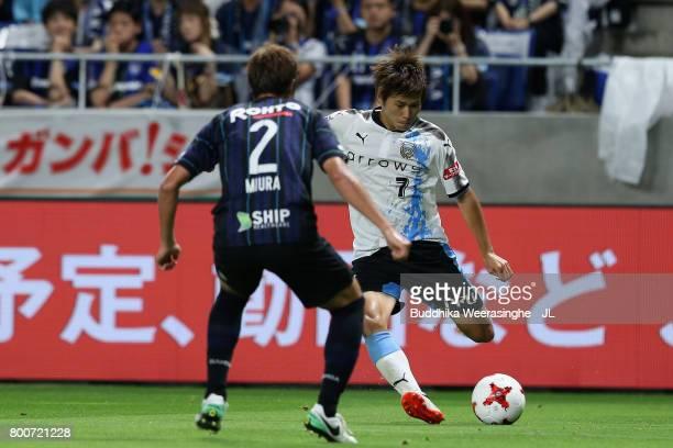 Shintaro Kurumaya of Kawasaki Frontale takes on Genta Miura of Gamba Osaka during the JLeague J1 match between Gamba Osaka and Kawasaki Frontale at...