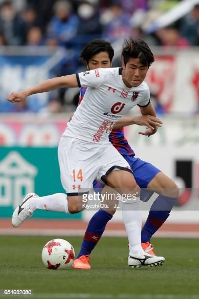 Shintaro Shimizu of Omiya Ardija and Shohei Ogura of Ventforet Kofu compete for the ball during the JLeague J1 match between Ventforet Kofu and Omiya...