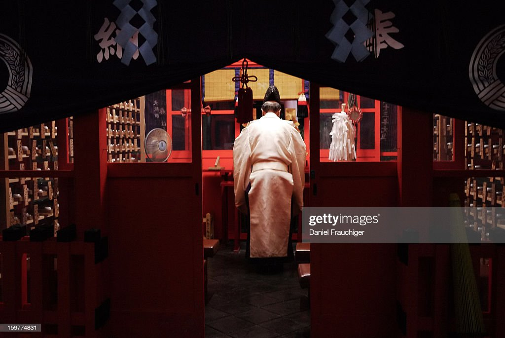 CONTENT] Shinto priest praying at the Fushimi Inari-Taisha shrine in Kyoto, Japan. October 15, 2011.
