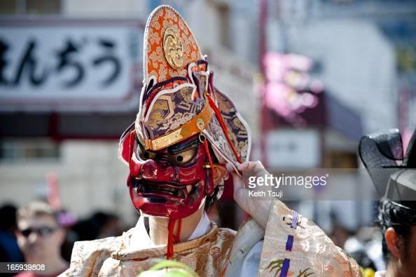 Shinto Priest wears a 'Tangu' mask parades through the streets at Kanamara Matsuri on April 7 2013 in Kawasaki Japan The festival is held annually on...