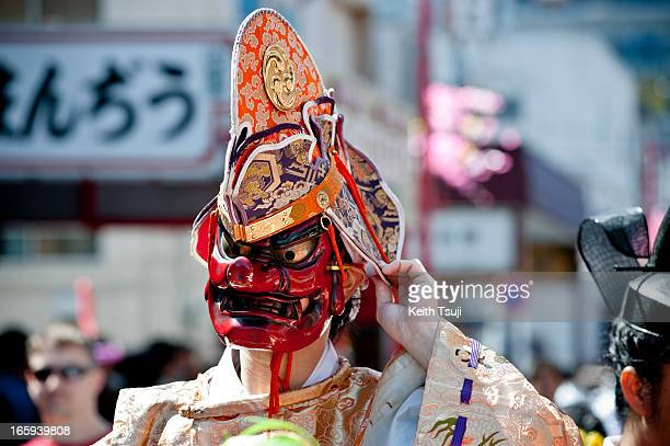 Shinto Priest wears a 'Tangu' mask parades through the streets at Kanamara Matsuri on April 7 2013 in Kawasaki Japan The festival is held annually on...